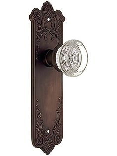 """circa 1905 Wrought Oil-Rubbed Bronze Lorraine Pattern Mortise Lock Set; Glass Knobs, Back Plate With/Without Keyhole; Pocket Door Pull With/without Keyhole; Door Bell Buzzer; Inset Sash Lift; OK for Pre-drilled Doors; Set for One Door; 5 Year Warranty; Item #: R-01CH-LOR-8853-TL; $104.90; Doorknobs 2"""" in diameter. Back plates 8 5/16"""" H x 2 9/16"""" W. Latch: Backset: 2 3/8"""" (non-standard 2 3/4"""" backset available). Latch case: 7/8"""" diameter. Latch face plate: 2 1/4"""" H x 1"""" W."""