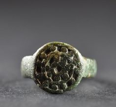Amlash bronze ring similar 1, 1st millenium B.C. Amlash bronze ring similar, 1.4 cm diameter bezel, 1.8 cm diameter ring size, 4.1 gr weight. Private collection