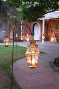 Northbrook Park Surrey- Brass lanterns on crooks by www.stressfreehire.com #venuetransformers