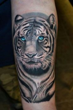 http://tattoomagz.com/tigers-tattoo/blue-eyes-tiger-tattoo/