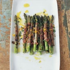 Pancetta-Wrapped Asparagus with Citronette | In Mario Batali's riff on the traditional antipasto of prosciutto-wrapped asparagus, he wraps spears in pancetta (which, unlike prosciutto, becomes nicely crispy when cooked) and grills them. Adding a bit of tanginess is the citronette, a marvelously bright-tasting mustardy-orange dressing.