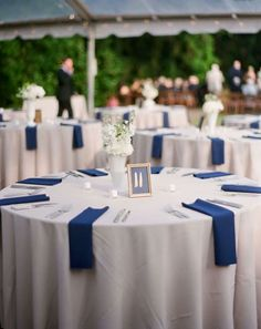 Royal blue and white table setting for a wedding reception                                                                                                                                                                                 More