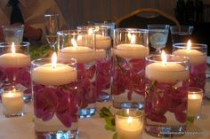 Simple. Low floating candles and flowers