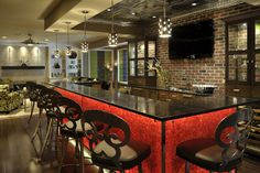 Love the red!  Lower Level contemporary bar - contemporary - basement - st louis - Savvy Surrounding Style