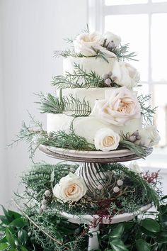 Winter wedding cake with roses and greenery
