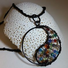 Wire Wrapped multicolored Swarovski Crystal Yen Yang necklace on black chain...approximately 18 INCHES.