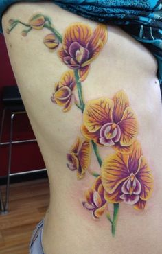 Orchid tattoo by Mindy Stewart at Studio XIII In Cocoa Beach Florida
