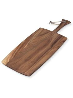 """This large rectangle paddleboard made from durable and strong Acacia wood is perfect for entertaining. It can be used as a cheese and charcuterie serving piece or for bread and hors d'ouevres.   Size: 14"""" x 8"""" x .5""""  Acacia is a wood species rich in history. In biblical times, it was used for bows and boats because of its extraordinary strength. It was used in the construction of the Arc of Covenant.   Wash Ironwood Gourmet™ products in warm, soapy water and thoroughly rinse with clean…"""