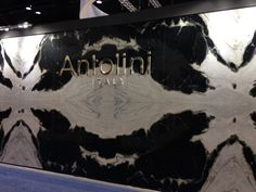 Antolini booth. Bookmatched dalmata marble