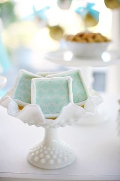 blue and white. pretty milk glass. love the quatrefoil pattern on the dessert.