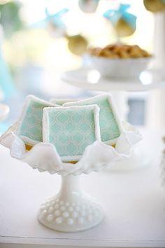 blue and white. pretty milk glass. love the quatrefoil pattern on the dessert.