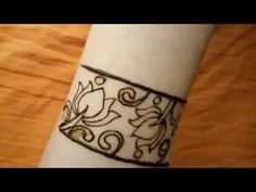 The Henna Bangle - Heavy fill style with lotus Latest Henna Designs, Back Hand Mehndi Designs, Full Hand Mehndi Designs, Legs Mehndi Design, Indian Mehndi Designs, Henna Art Designs, Mehndi Designs For Girls, Mehndi Designs For Beginners, Modern Mehndi Designs