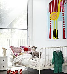 Iron bed from Ikea + Marimekko elephant print