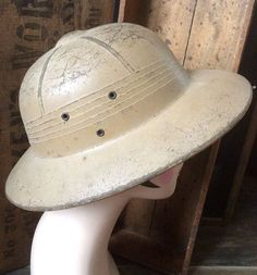 Check out this item in my Etsy shop https://www.etsy.com/listing/287571801/authentic-vintage-jungle-safari-pith-hat