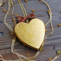 Gilded with Real Gold, this Traditional Heart is a Unique Luxury Gift!  Get yours today with 40% discount!   All products in Golden Edition are made of high quality Mountain Maple Wood. Radiant hand Gilded decorations are complemented with clear crystals and stunning ribbons in red and gold shades. The whole process is hand made, including the magical branded gift wrapping from Choralis Art.  #goldenheart #heartofgold #heartdecoration #woodenheart #heartornament Golden Heart, Heart Of Gold, Heart Wall, Heart Ornament, Heart Decorations, Luxury Gifts, Clear Crystal, Wood Art, Ribbons