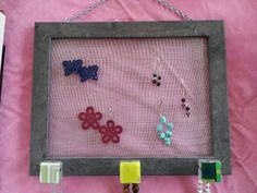 Murami jewelry organizer hangs on the wall and displays and organizes jewelry.