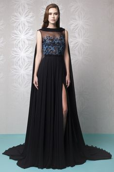 Spring Summer 2016 Tony Ward - Black Silk Georgette evening dress with a cape and a gathered, slit skirt, featuring an illusion neckline and a Sapphire Blue and Black embroidered bodice.
