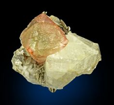 Pink near transparent octahedral Fluorite set aesthetically upon white Adularia and Muscovite. Very pretty! From Nagar, Hunza Valley, Gilgit District, Northern Areas, Pakistan