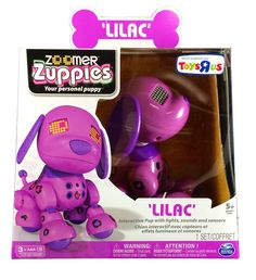 #Zoomer Zuppies Interactive Puppy - Lilac You'll love the unique bond that forms between you and your Zoomer Zuppies Interactive Puppy in the Lilac style when you scratch her tummy, pat her head and cuddle together. Each Zoomer has a distinct personality, and Lilac is no exception. She loves to have fun and play games like Ping Pong and Bop It with you. Toys & Games