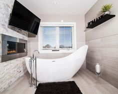 Bathroom Design, Cool Modern Bathroom With White Unique Bathtubs Shaped Also Comely Modern Faucet And Mixer Tap Also Light Grey Wall Paint Color Also Modern Windows With White Frame And Blinds Also Modern Gas Fireplace: Unique Bathroom Mirrors for an Ultimately Outstanding Bathroom