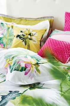Large scale floral waterlily print double duvet cover in white, pinks and greens by Designers Guild.