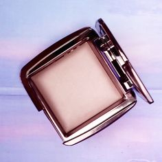 Create your #perfectlight with the #AmbientLighting Collection. Seen here – Mood Light: A soft, sheer lavender pink powder that mimics the softest, most forgiving light and brightens the complexion. #hourglasscosmetics