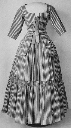 Matching jacket and skirt summer outfit made from striped cotton and silk fabric (white silk stripes and brick red cotton).    Nordiska Museet, Stockholm, Sweden
