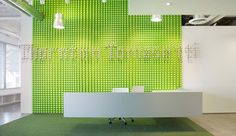 Company brand wall made from green safety caps