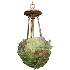 Unusual Light Pendant with Green Glass Florets | From a unique collection of antique and modern chandeliers and pendants at https://www.1stdibs.com/furniture/lighting/chandeliers-pendant-lights/