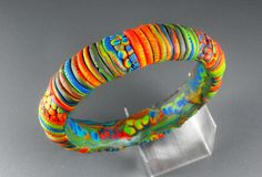 Rainbow Bangle by MargitB., via Flickr -VV. Wrap a shrinky-dink braclet.
