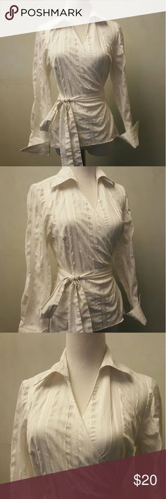 LOFT wrap shirt Loft white wrap button shirt. Has double sided buttons, has  silver stipes has a small stain Shown in pic7 LOFT Tops Blouses
