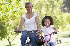 Grandmother and granddaughter on bikes