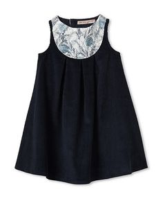 contrasting fabric bib on a simple dress