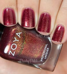 Zoya Teigen | Fall 2014 Ignite Collection | is a sparkling pinky raspberry with strong gold and red shimmer mixed in.