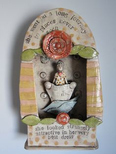 A ceramic wall hanging box with travelling woman or man/ Art for the wall. £130.00, via Etsy.