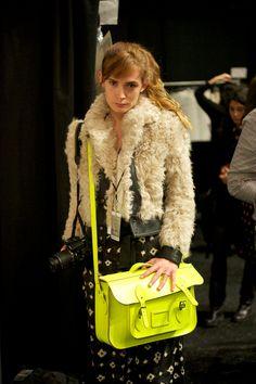 Neon satchel is from Cambridge Satchel Company