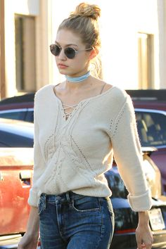 Gigi Hadid simply ties a suede string around her neck to get the choker effect.    - HarpersBAZAAR.com