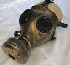 Antique GOLD STEAMPUNK Gas Mask - Distressed Apocalyptic, Futuristic Full Face Survival Mask with Filter. $49.50, via Etsy.