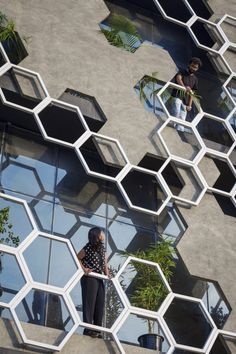 To buffer the facade from extreme heat, concrete panels with standoff metal hexagon frames create visual interest at Hexalace in India by Studio Ardete architecture Architecture Metal, Futuristic Architecture, Amazing Architecture, Building Architecture, Fashion Architecture, India Architecture, Contemporary Architecture, Contemporary Design, Facade Design