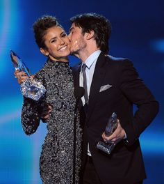 Ian Somerhalder gave Nina Dobrev a kiss while they accepted their award!