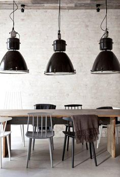 = black pendants and mixed chairs
