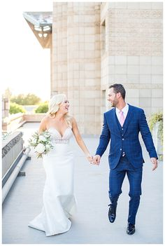 bride in two piece wedding dress and groom in custom blue suit on the rooftop at Arizona Biltmore