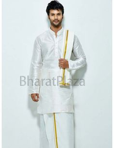 Pleasurable white color raw silk kurta with resham embroidery around the placket part and high neck collar. Comes with matching cotton dhoti and angavastram with golden zari border. Shop Now at: bit.ly/1svGPKn