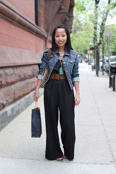 Black jumpsuit,  wide belt and denim jacket