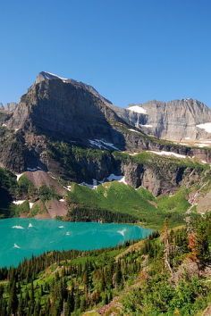 """""""The Grinnell Glacier Trail is one of the most scenic hikes in Glacier National Parks. When hiking the Grinnell Glacier Trail, a hiker will pass by crystal clear mountain lakes, towering mountains and will have the unique opportunity to stand on a glacier if one chooses. The trail runs for 6 miles and has a vertical gain of 1600 feet. The first two miles of the trail are essentially flat. Beyond that, the trail has a gradual incline up to its end. The trail ends at Upper Grinnell Lake..."""