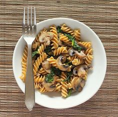 Whole Grain Fusilli with browned Mushrooms and Spinach.