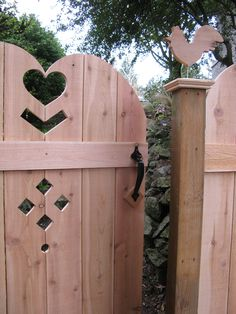 rooster cedar art fence and gate
