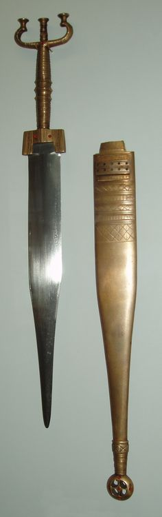 "Celtic dagger and sheath made of iron and bronze, found in the grave of a celtic prince in Hochdorf, Germany aka the man with the golden shoes, the Hochdorf prince. Some corals as decoration are on the hilt and on the sheath. The dagger has a length of around 42 cm (16.5"")."