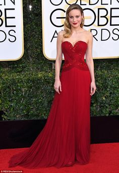 Red hot!The 27-year-old actressflaunted her svelte figure in a strapless crimson Rodarte...