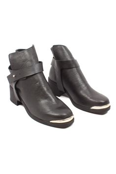These boots are no joke - they add just the right amount of edge to any outfit. Essex Ankle Boots, $46.40, www.mooreaseal.com